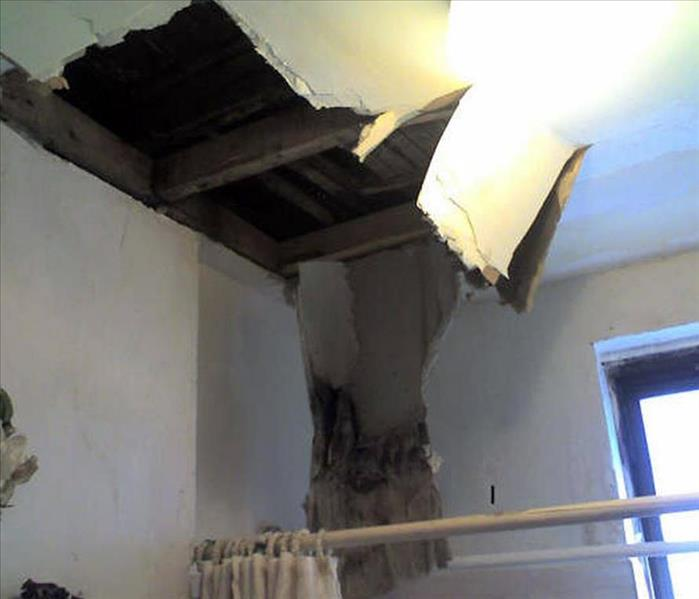Leaking Roof Causes Ceiling Collapse
